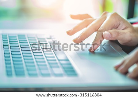 Hand using computer PC working business - stock photo