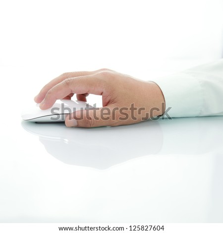 Hand using mouse - stock photo