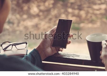 hand using phone - stock photo