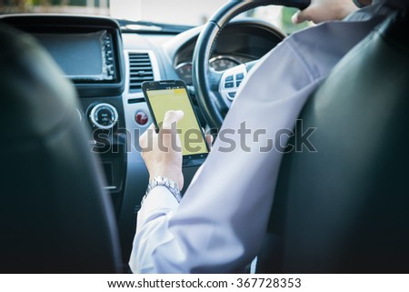 Hand using phone sending a text while driving to work ,businessman ,colorful color tone