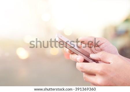 Hand using smart phone - stock photo