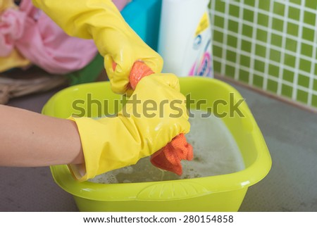 Hand washing clothes - stock photo