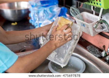Hand washing dirty stains from food.