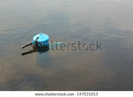 Hand water pump under water after flooding