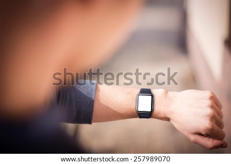 Hand wearing elegant smartwatch with blank screen. - stock photo