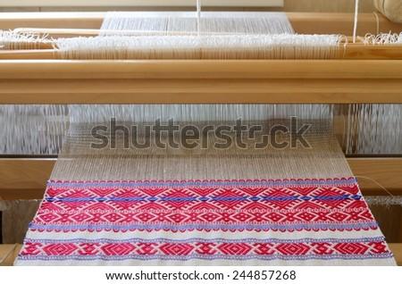 Hand weaving machine - stock photo