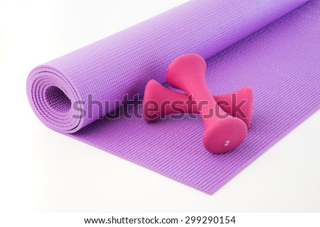 Hand weights and mat after workout sweat - stock photo