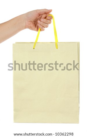 Hand whit bag a over white background - stock photo