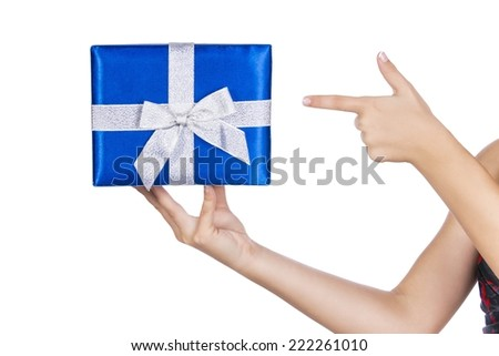 Hand with a blue gift box with silver bow isolated on white background  - stock photo