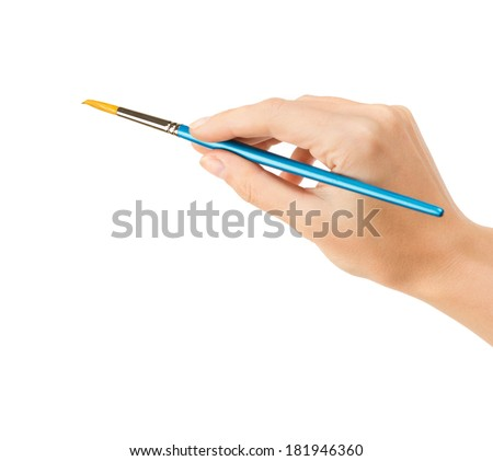 Hand with a brush on white background  - stock photo