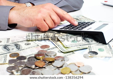Hand with a calculator. Money saving concept. - stock photo