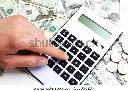 Hand with a calculator. Money saving concept.