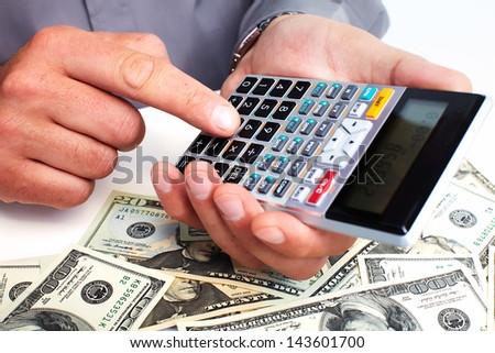 Hand with a calculator. Money saving concept. - stock photo
