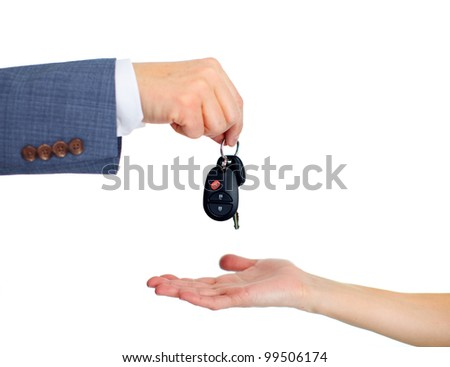 Hand with a Car keys. Isolated on white background. - stock photo