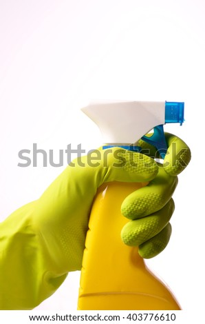 Hand with a cleaning spray bottle on a white background