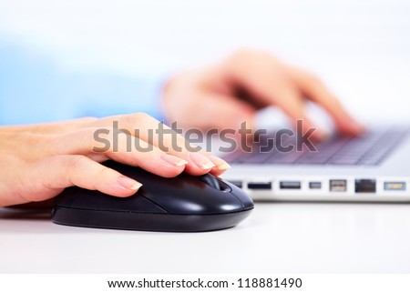 Hand with a computer mouse. Business technology background.