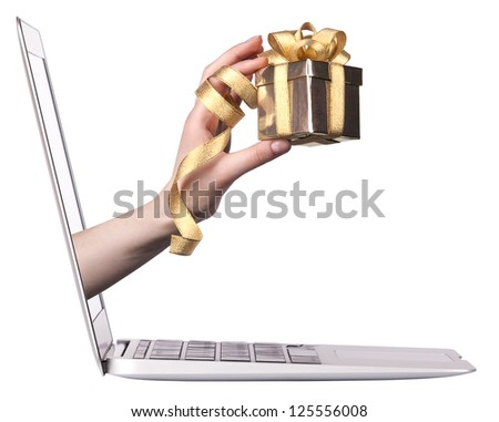 hand with a gift and laptop - stock photo