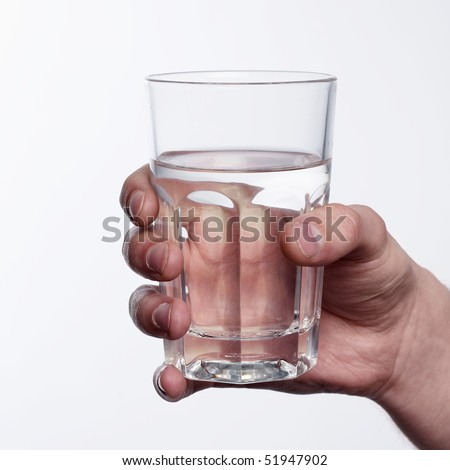 Hand with a glass of water - stock photo