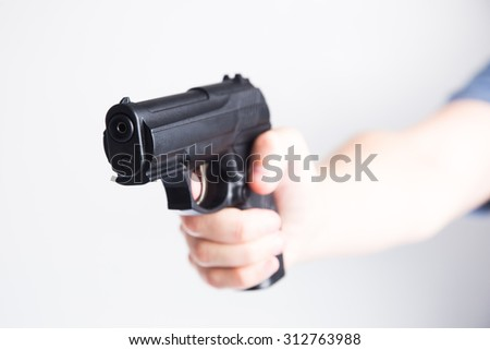 hand with a gun - stock photo