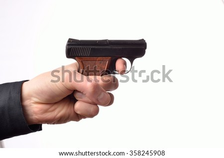 Hand with a handgun on a white background - stock photo