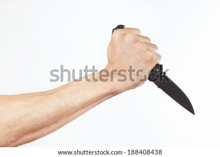 Hand with a knife on a white background - stock photo