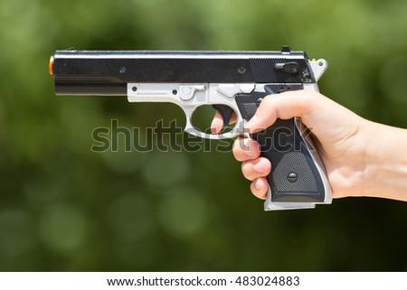 Hand with a laser gun closeup