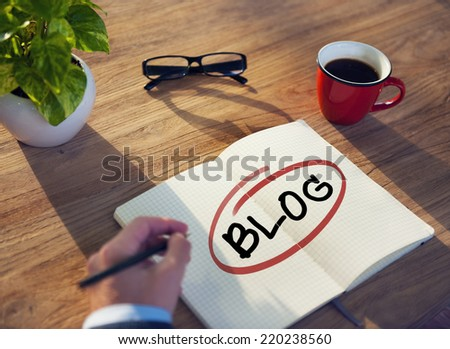 Hand with a Note and a Single Word Blog  - stock photo