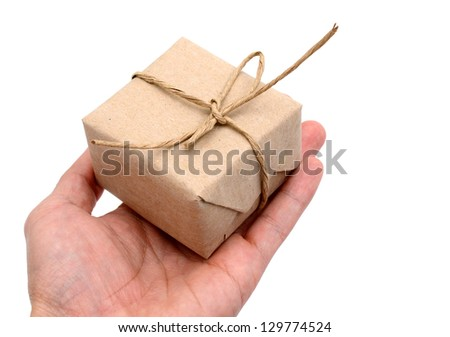 Hand with a parcel gift isolated on white background
