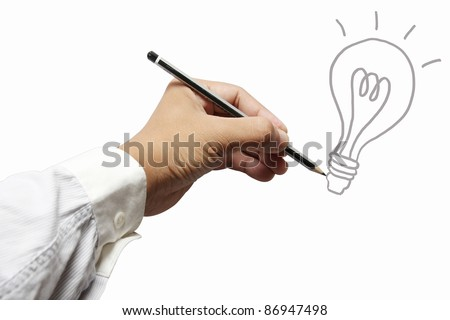 hand with a pencil drawing light bulb - stock photo