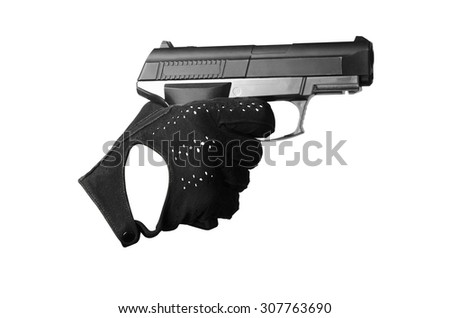 hand with a pistol in a black glove aim and pulled the trigger - stock photo