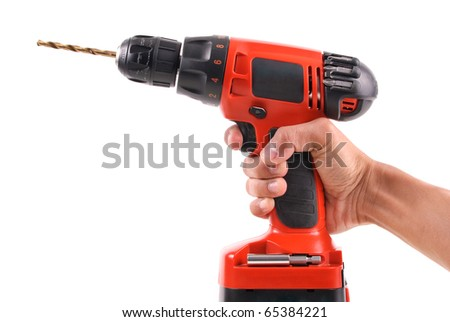 Hand with a Power Dril - stock photo