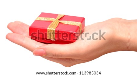 Hand with a small red gift box with gold bow isolated on white background - stock photo