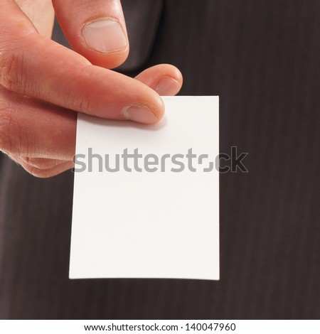 Hand with a visit card - stock photo