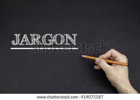 Hand with a white pencil writing: JARGON