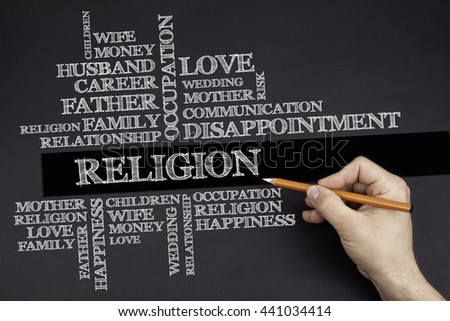 Hand with a white pencil writing: Religion word cloud - stock photo