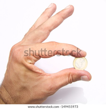 hand with an euro coin