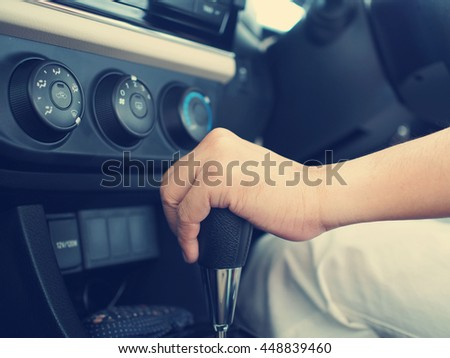 hand with auto gear of sport car, gear handle , new technology of transportation.