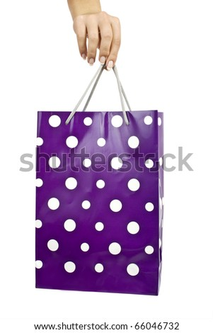 Hand with bag isolated on white background - stock photo