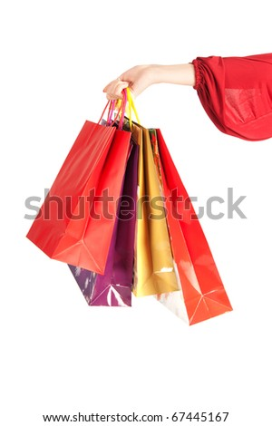 hand with bags isolated on white - stock photo