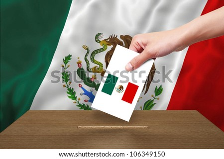 Hand with ballot and wooden box on Flag of Mexico - stock photo