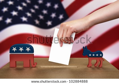 Hand with ballot and wooden box on Flag of USA, party icon - stock photo