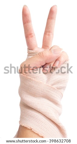 hand with bandage in white background : victory shape - stock photo