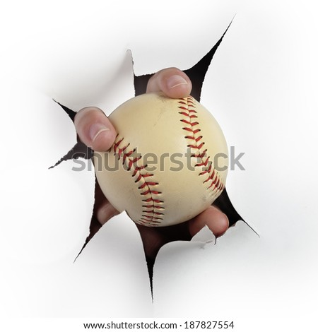 Hand with baseball coming out the paper hole isolated on white background  - stock photo