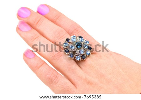 Hand with big ring isolated on white
