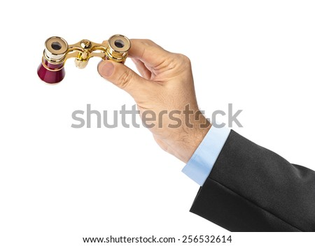 Hand with binoculars isolated on white background - stock photo