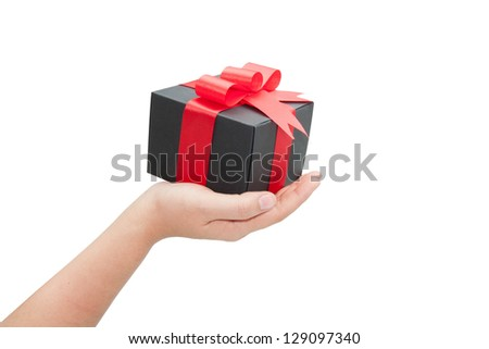 hand with black gift box on white background - stock photo