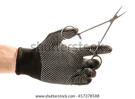 Hand with black glove holding a medical clamp . Isolated on white background - stock photo