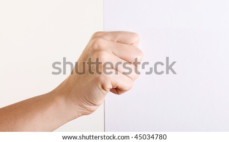 Hand with blank paper over white background - stock photo
