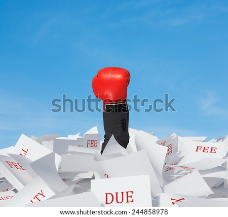 hand with boxing glove in papers heap on a sky background - stock photo