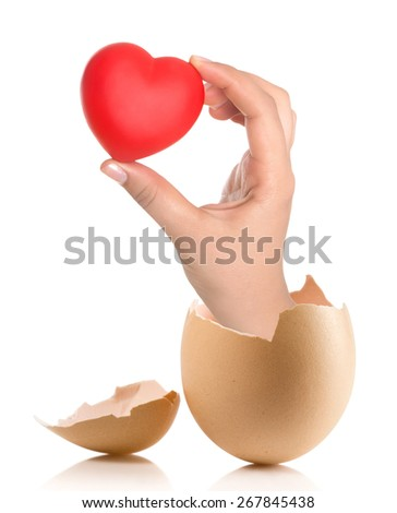 Hand with broken egg isolated on white backround - stock photo